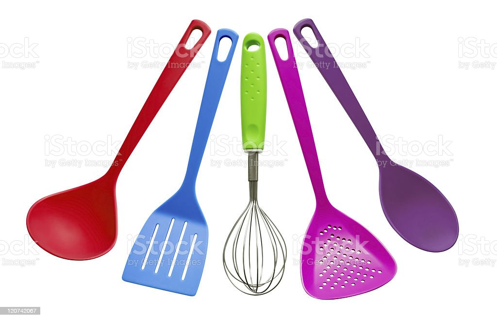 Five different kitchen utensils in a variety of colours stock photo