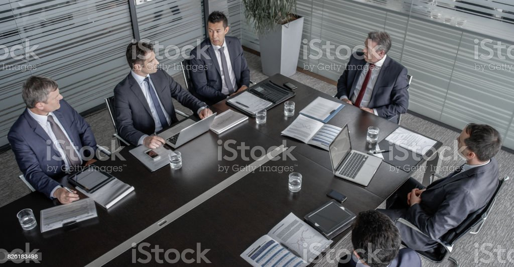 Five directors and CEO in meeting stock photo