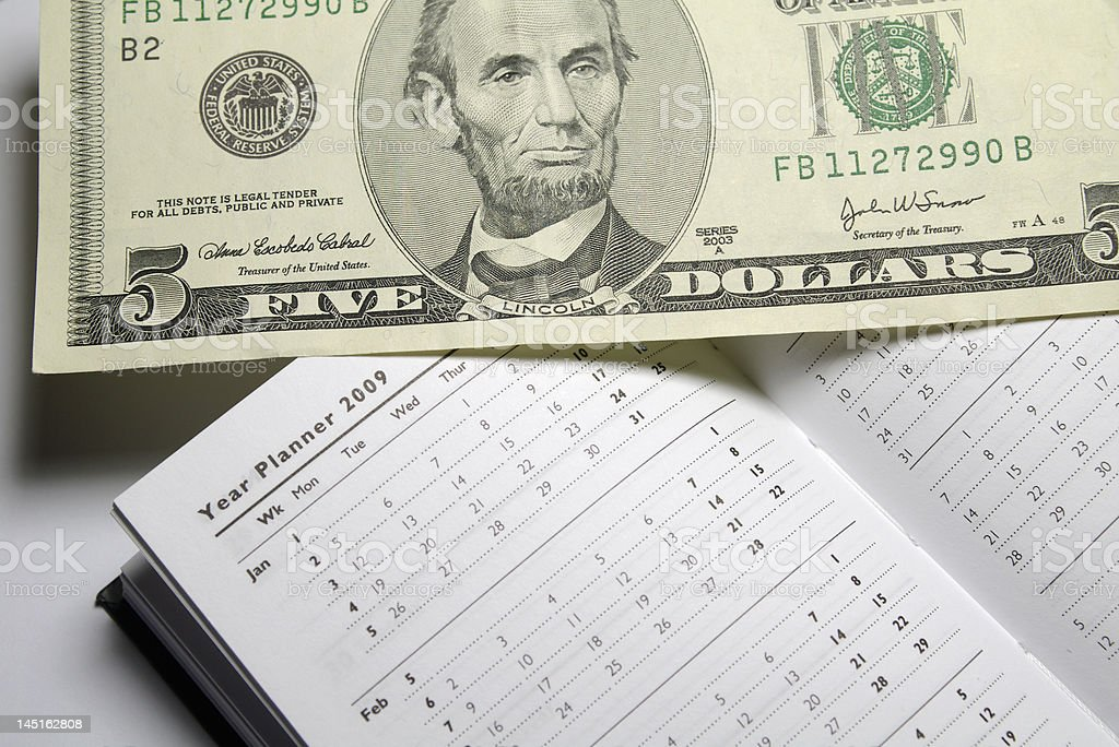 Five Dollar Bill and 2009 Year Planner royalty-free stock photo