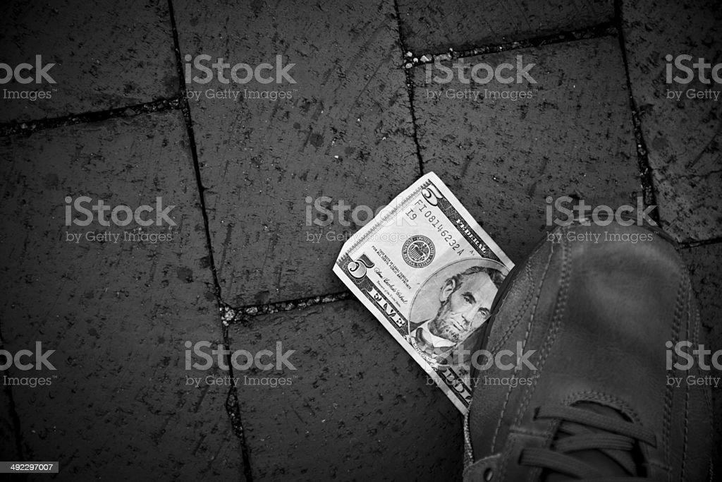 US five dollar bill at the street stock photo