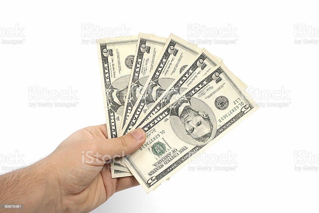 Five dollar bills held in a man's hand stock photo
