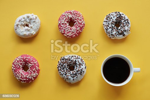 istock Five donuts with cup of coffee 636092026