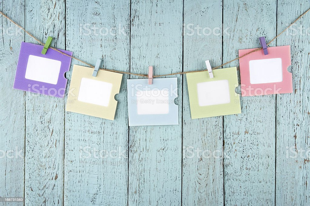Five empty photo frames hanging with clothespins royalty-free stock photo