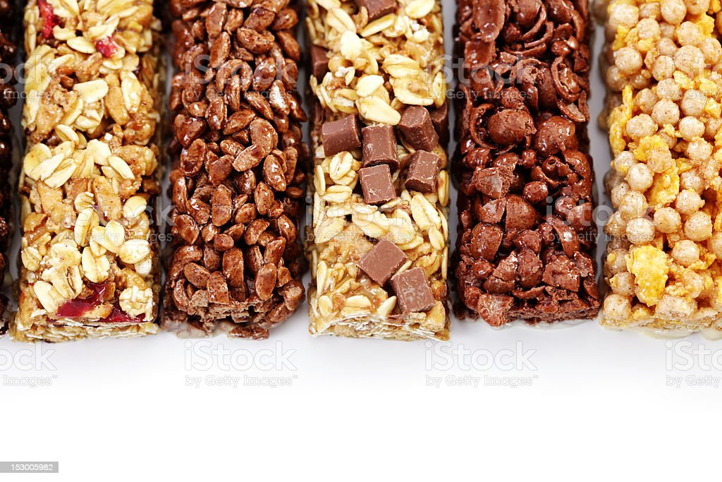 Five energy bars made out of a variety of ingredients stock photo