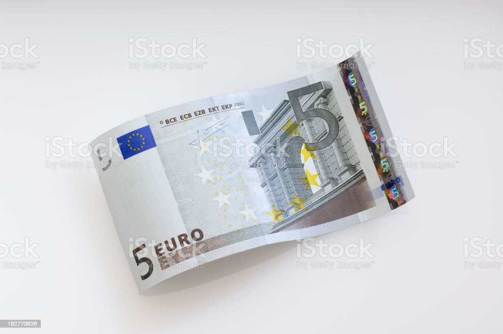 Five Euro dollar waves on the plain cream background royalty-free stock photo