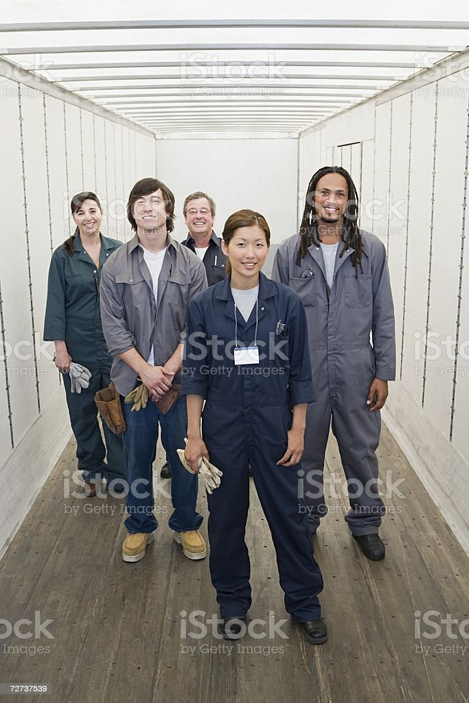 Five factory workers stock photo