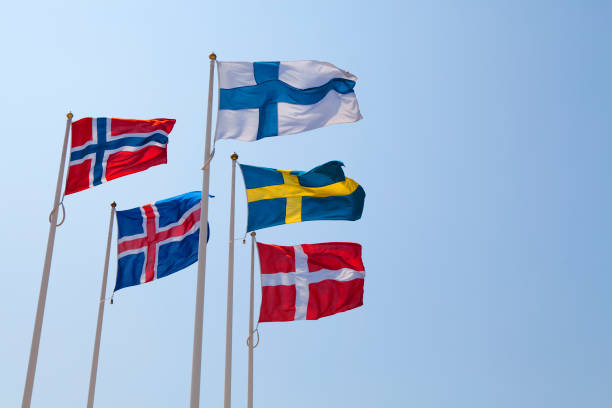 Five flags of Nordic Countries blowing in the wind stock photo