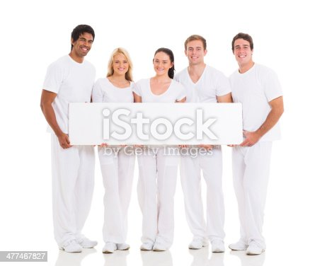 1048561866 istock photo five friends holding white board 477467827