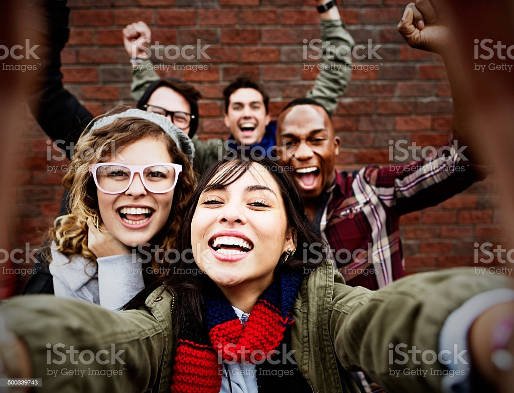 Five friends take happy, smiling selfie stock photo