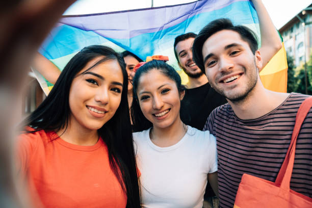 Five friends taking a selfie together at an LGBTQI Pride event stock photo
