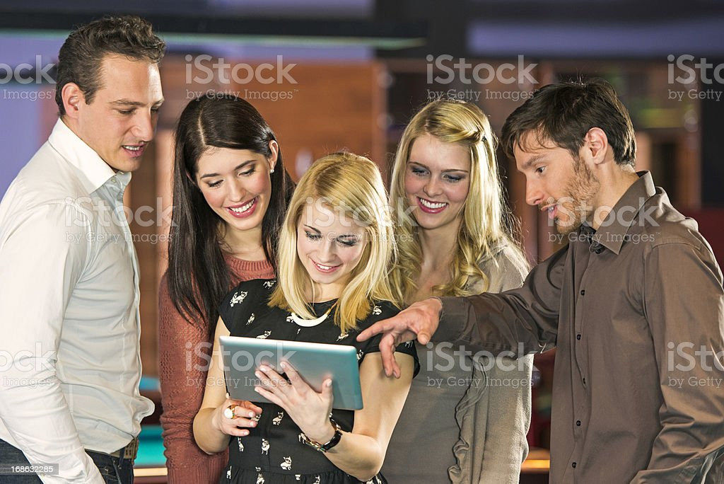 Five Friends Watching Digital Tablet royalty-free stock photo