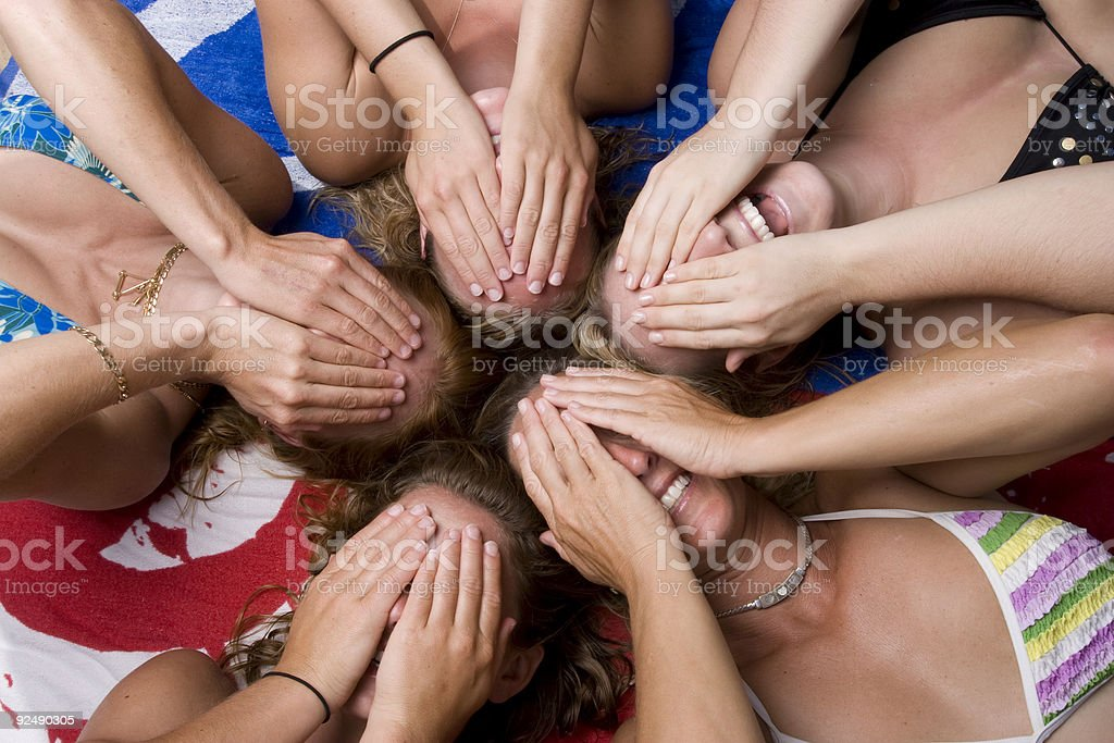 Five girls laying back hands over eyes royalty-free stock photo