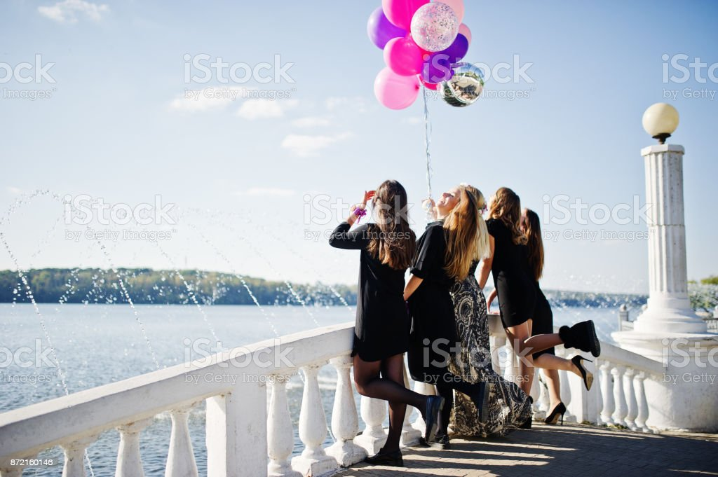 Five girls wear on black having fun at hen party. stock photo