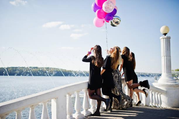 Five girls wear on black having fun at hen party. - foto stock
