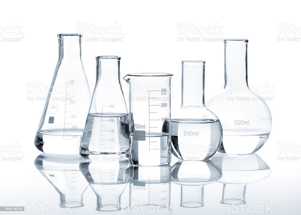 Five glass flasks with a clear liquid stock photo