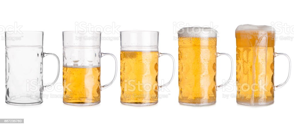 Five Glass Mugs with Beer Sorted From Empty to Full stock photo