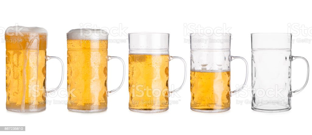 Five Glass Mugs with Beer Sorted From Full to Empty stock photo