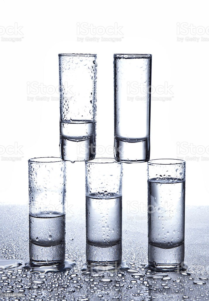 five glasses of vodka stock photo