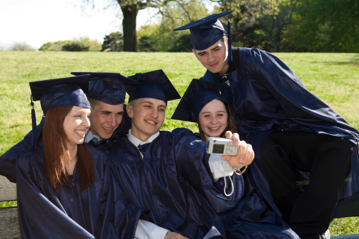 Five graduates taking picture