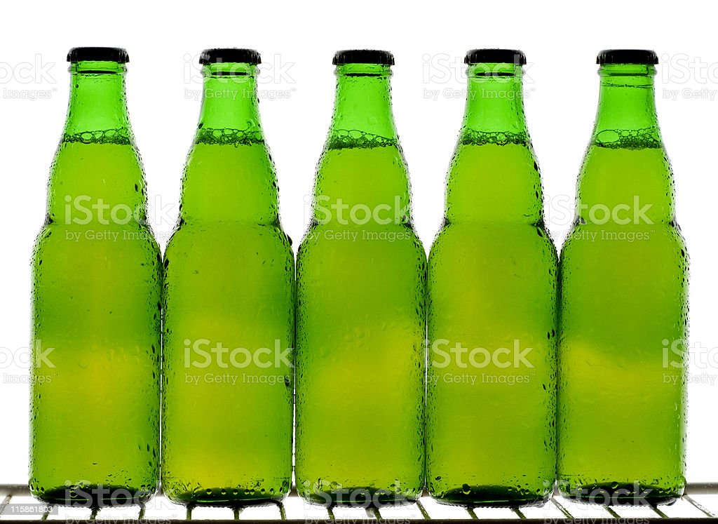 Five green beer bottles royalty-free stock photo