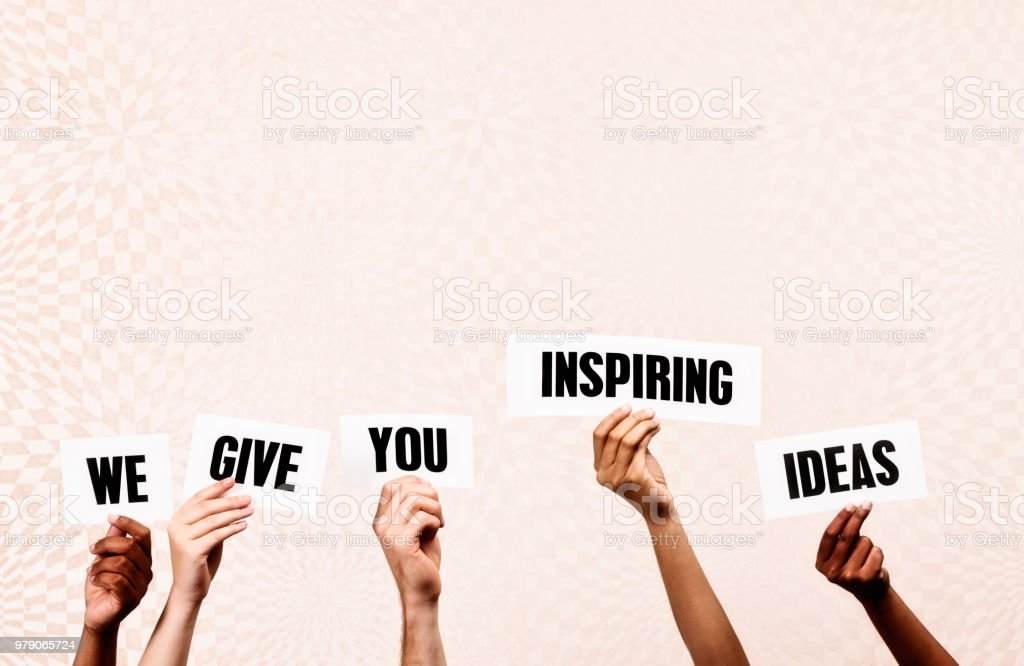 Five hands hold up signs reading We give you Inspiring Ideas.