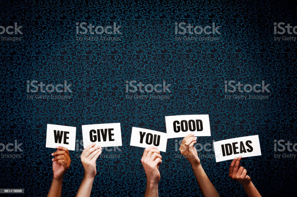 Five mixed hands hold up printed signs reading \'We give you good...