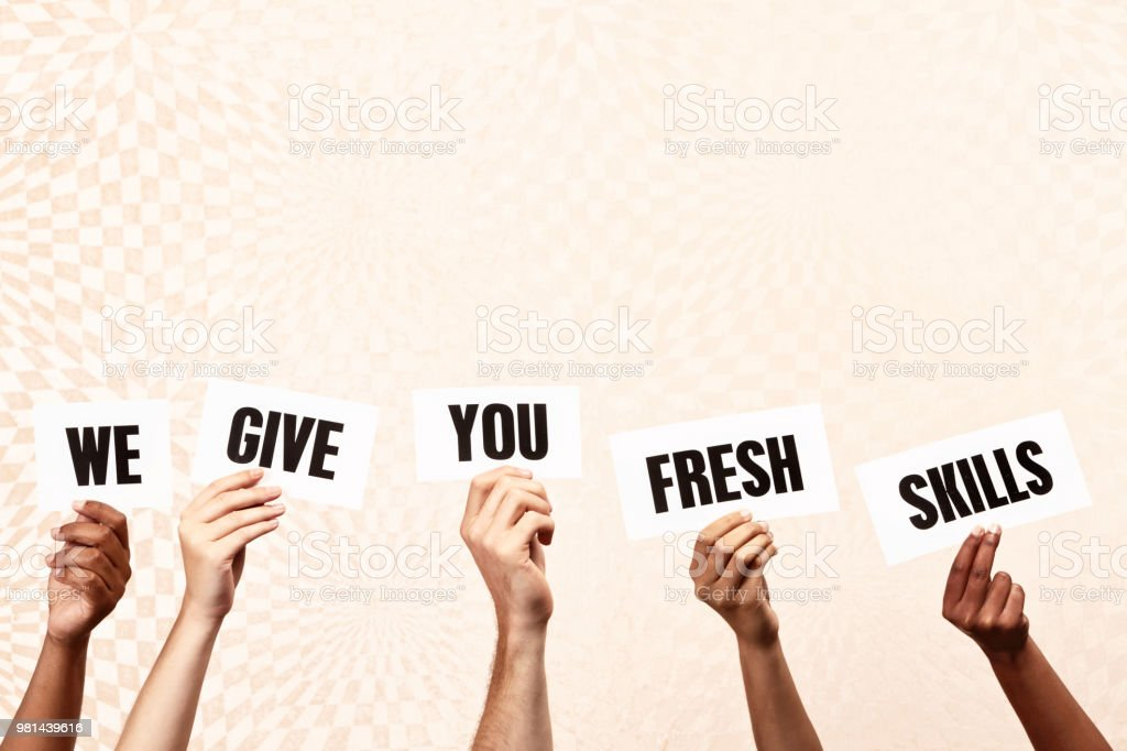 Five mixed hands hold up printed signs reading \'We give you fresh...