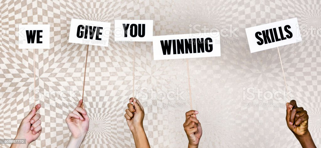 Five mixed hands hold up signs reading \'We give you winning skills\'