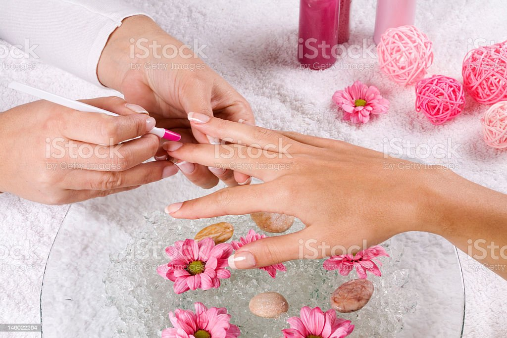 Five hands stacked together on a white background royalty-free stock photo