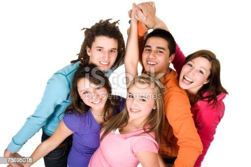 istock Five happy teenagers students action young women men mixed race 173695018