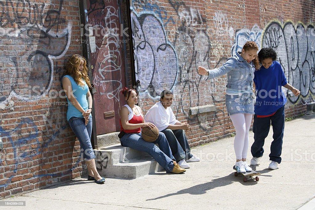 Five Hispanic teenagers on the sidewalk royalty-free stock photo