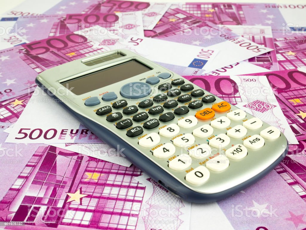 Five hundred 500 Euro bills banknotes with calculator, European currency money background stock photo