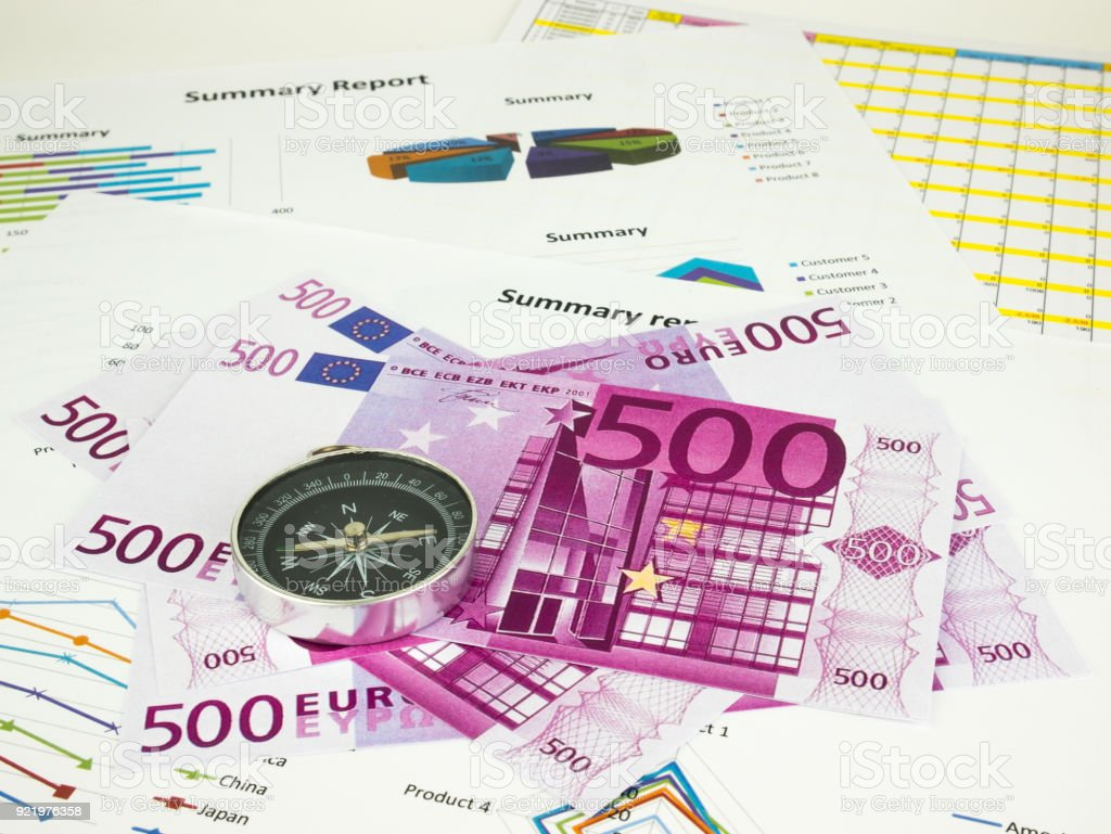 Five hundred 500 Euro bills banknotes with Compass, Business background stock photo