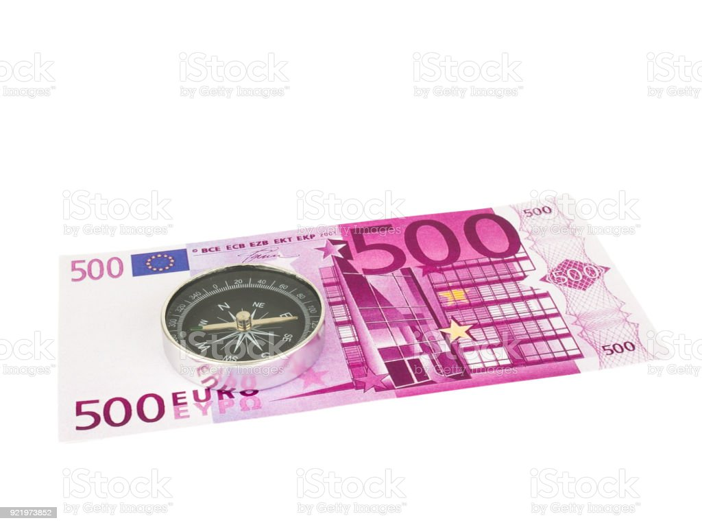 Five hundred 500 Euro bills banknotes with Compass isolated on white background, Clipping path. stock photo
