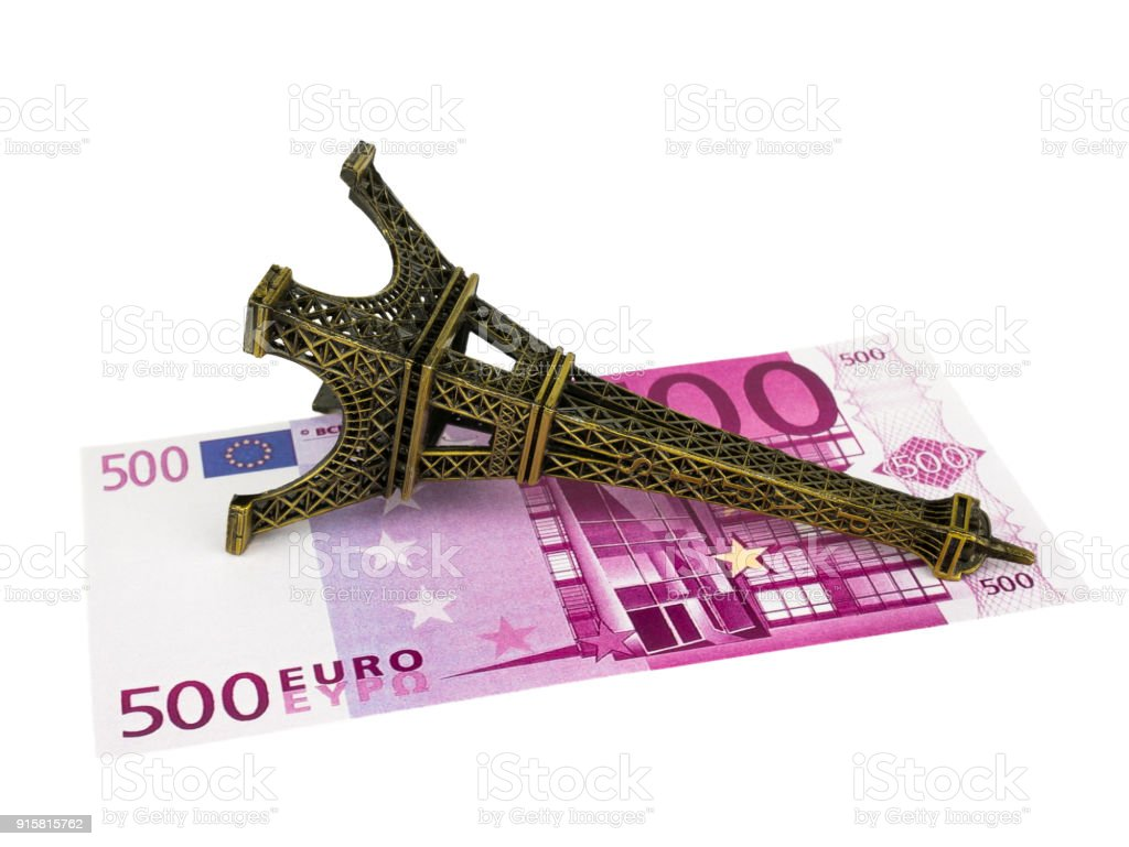 Five hundred 500 Euro bills banknotes with Eiffel tower replica, isolated on white  background stock photo