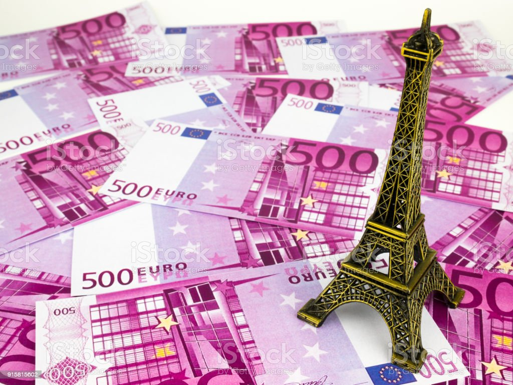 Five hundred 500 Euro bills banknotes with Eiffel tower replica, European currency money background stock photo