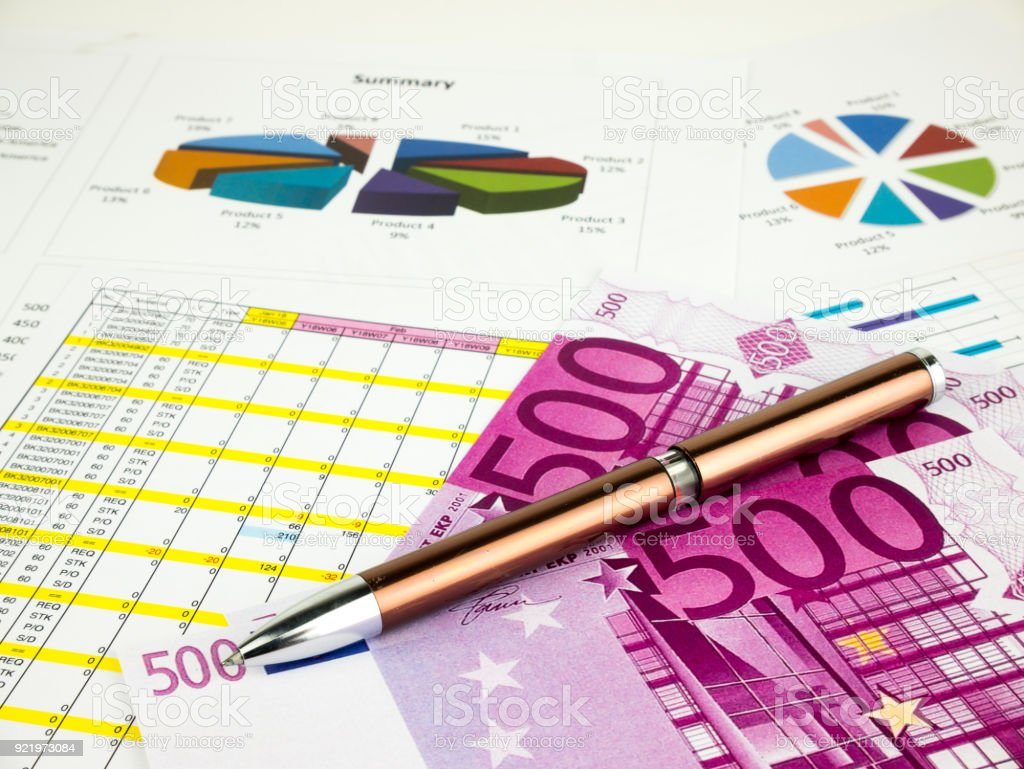 Five hundred 500 Euro bills banknotes with pen, business  background stock photo