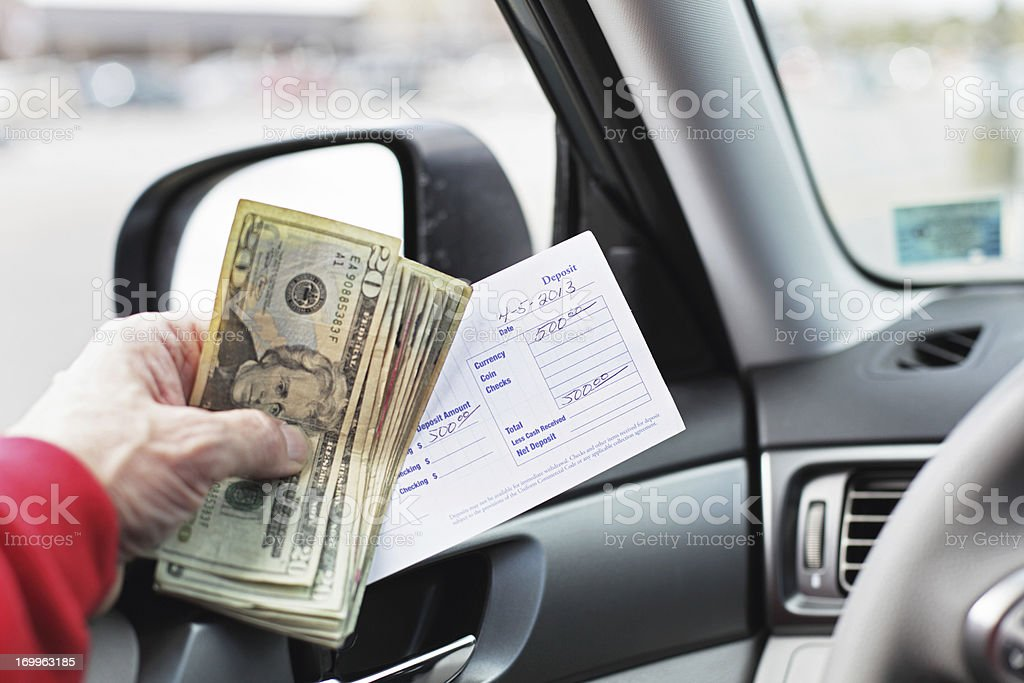Five Hundred Dollar Drive Through Bank Deposit stock photo