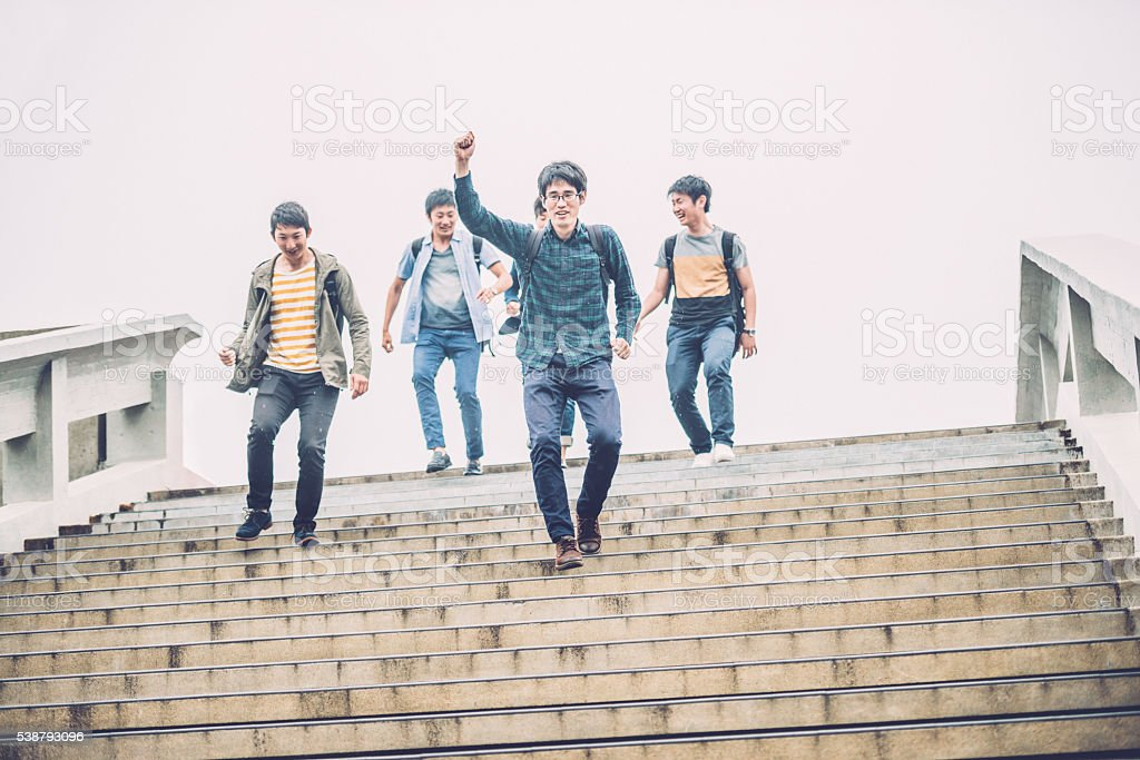 Five Japanese Students Descending Staircase, Campus, Kyoto, Japan, Asia stock photo