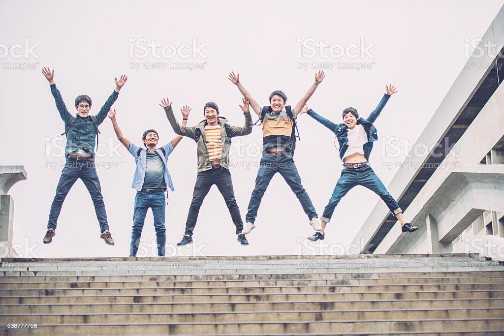Five Japanese Students Jumping, Campus, Kyoto, Japan, Asia stock photo