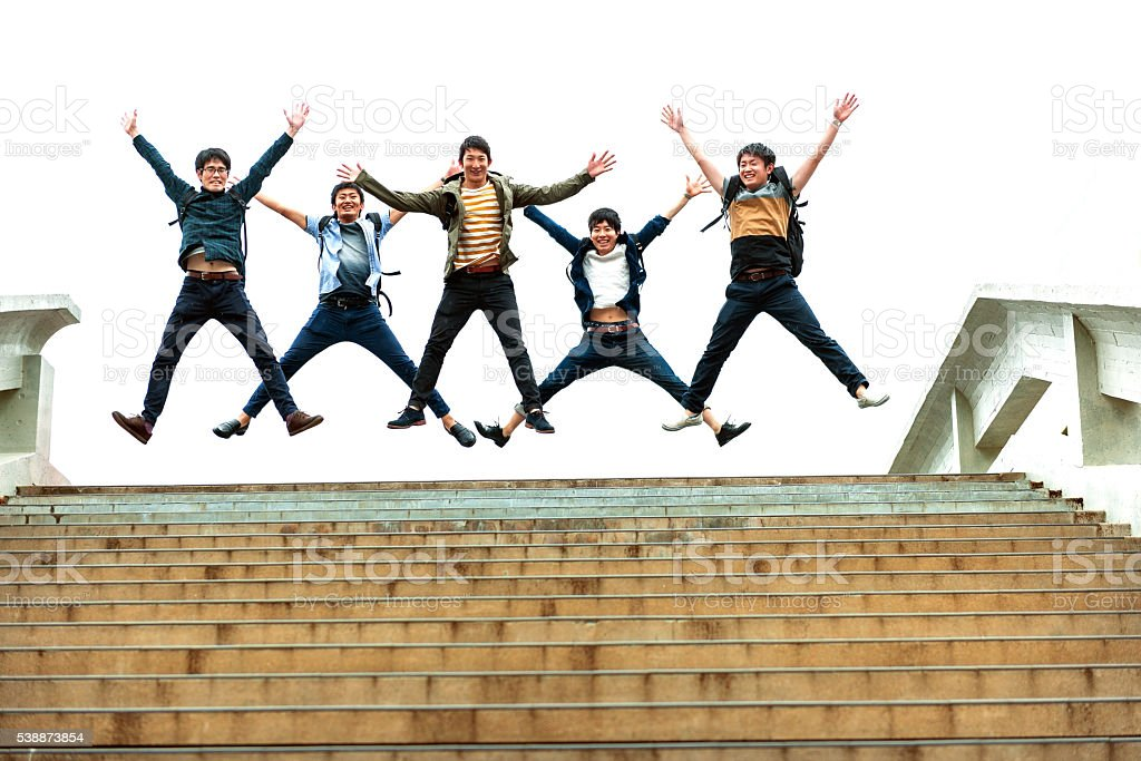 Five Japanese Students Jumping, Campus, Kyoto,Japan stock photo