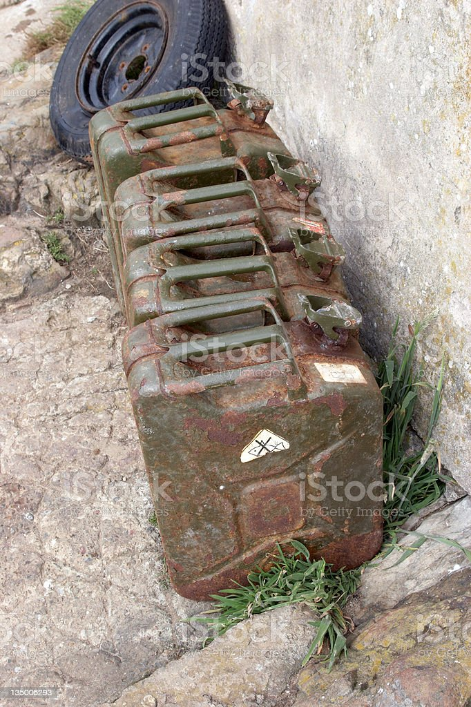 Five Jerry cans and tyre royalty-free stock photo