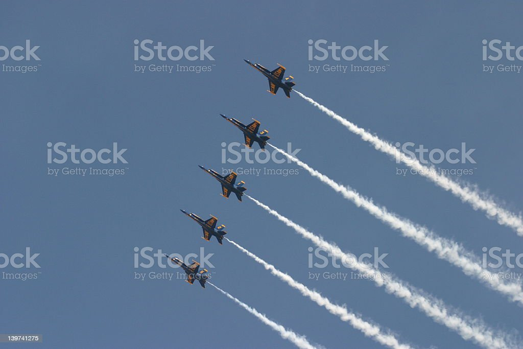 Five jets flying in formation across the blue sky stock photo