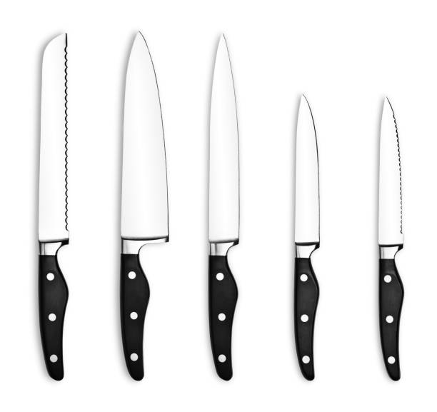 Five kitchen knives on a white background stock photo