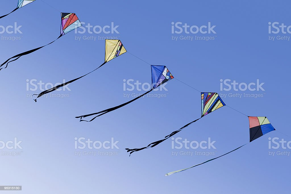 Five kites in a row stock photo