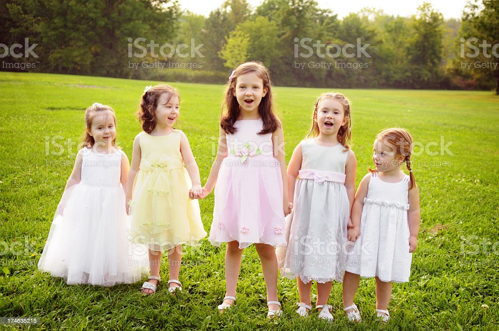 Five Little Princess Girls Wearing Dresses and Holding Hands royalty-free stock photo