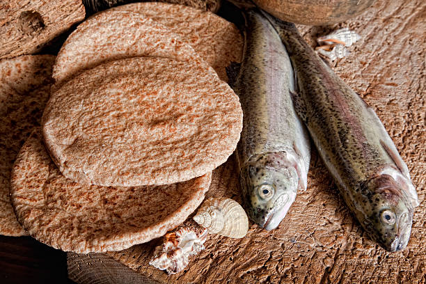 Five loaves of bread and two fish stock photo