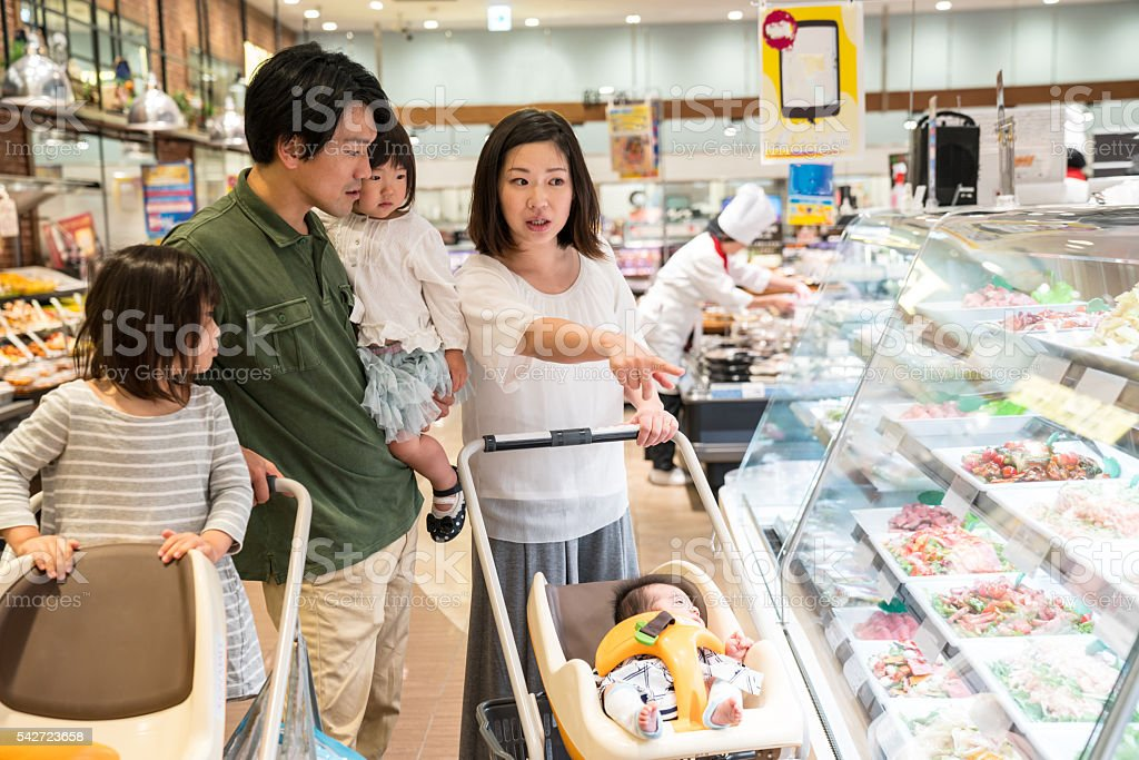 Five member family shopping at a supermarket stock photo