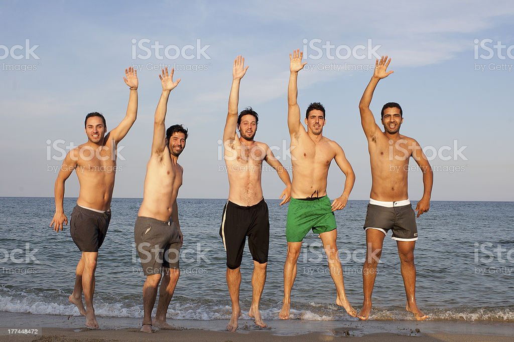 Five men jumping with arm up stock photo