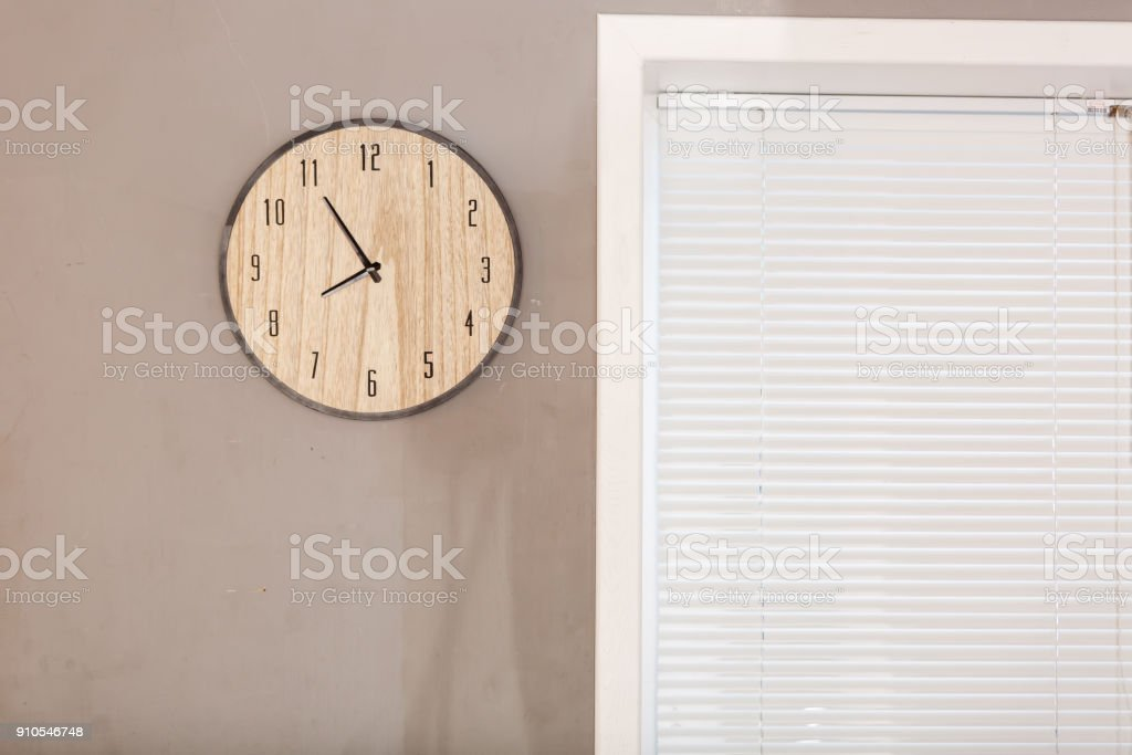 Five minutes to eight o clock on the dial round wall clock stock photo